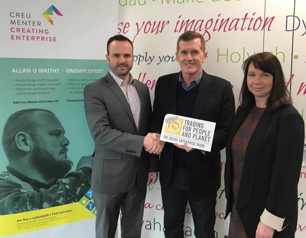Creating Enterprise's Chairman Peter Parry (centre) presents the Social Enterprise Mark to Adrian Johnson, MD (l) and Sharon Jones, Director (r)